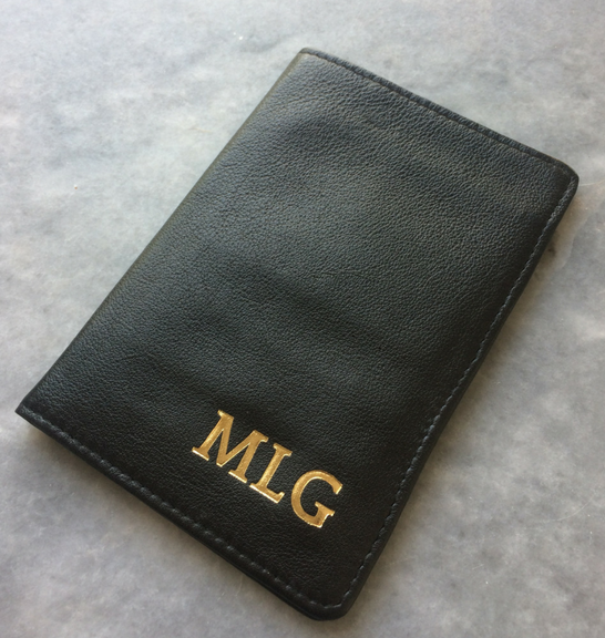 Black genuine leather passport cover with Gold personalisation sample
